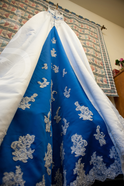 White and royal blue wedding gown.