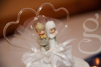 Precious Moments cake topper of bride and groom.