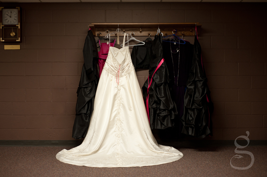 The wedding dress hanging up.
