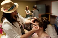 The bride getting her makeup done.