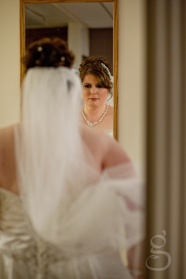 The nervous bride checking out her reflection before the ceremony.