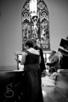 The flower girl sitting in the pew.