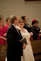 Bride and groom share a quiet moment during the ceremony.