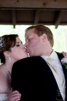 A quick kiss for the bride and groom.