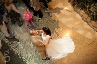 Bride and groom holding each other in the reception hall of the Kalahari resort in Wisconsin Dells.