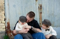 father and sons giggling at their family session.