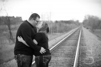 Just about to kiss on the railroad tracks.