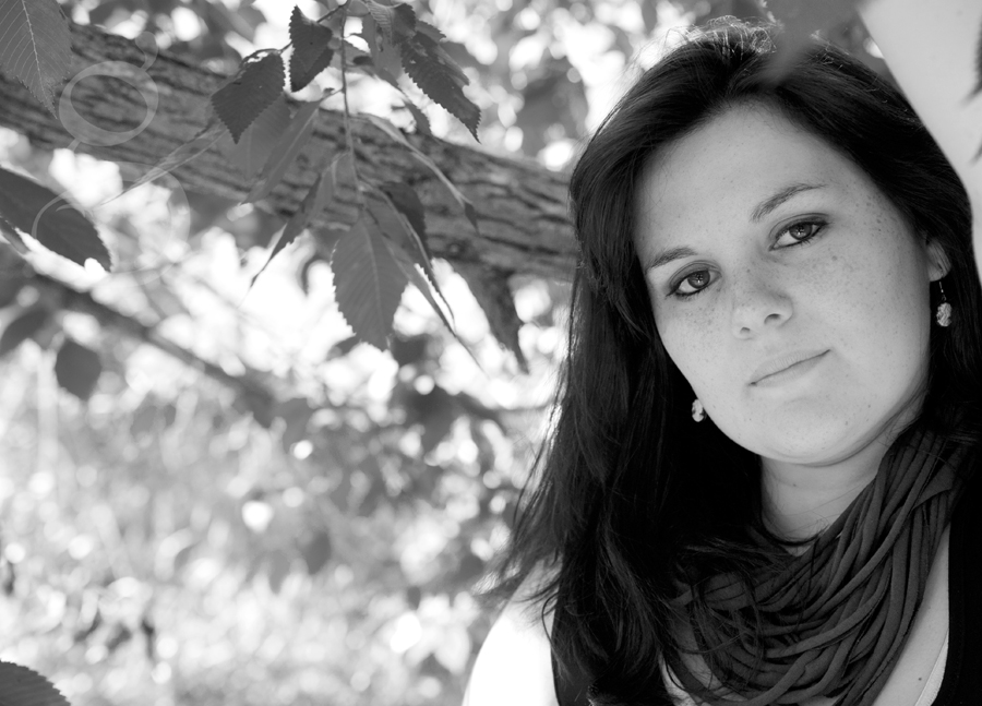 black and white shot under a tree for senior pictures of Emily.