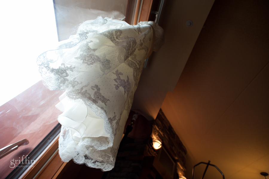 Lace covered wedding gown from Brides n Belles in Reedsburg, WI, hanging in the window of the Chula Vista suite.