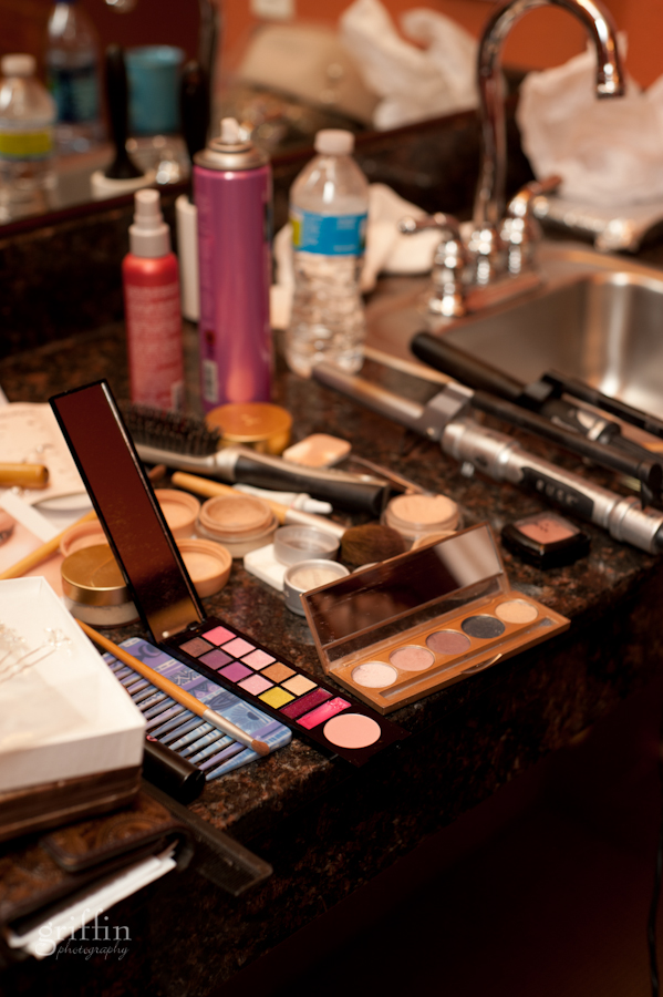 Wedding makeup laid out on the bathroom sink, eyeshadows and blushes.