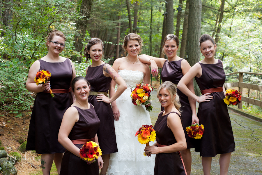 The bridesmaids with their bouquets from Wild Apples on the path through the bluffs.