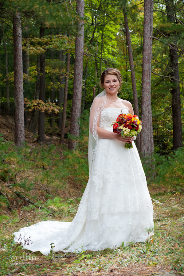 Jenelle in her wedding gown from Brides n Belles with her gorgeous fall bouquet from Wild Apples floral in Baraboo.