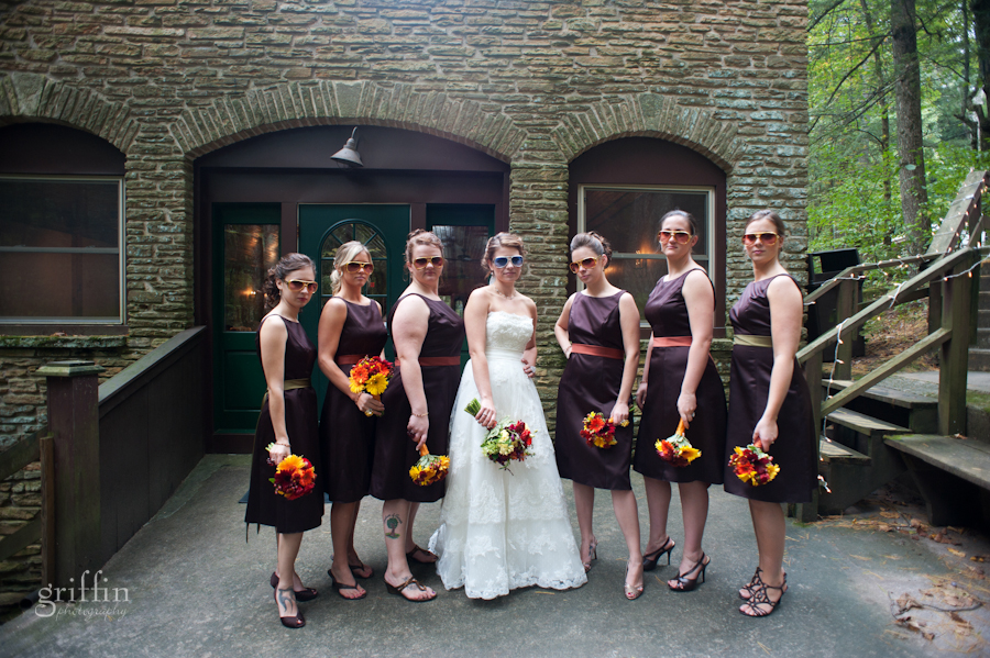 the bridesmaids rocking their sunglasses in front of the brick building down at Coldwater Canyon on the Wisconsin River.