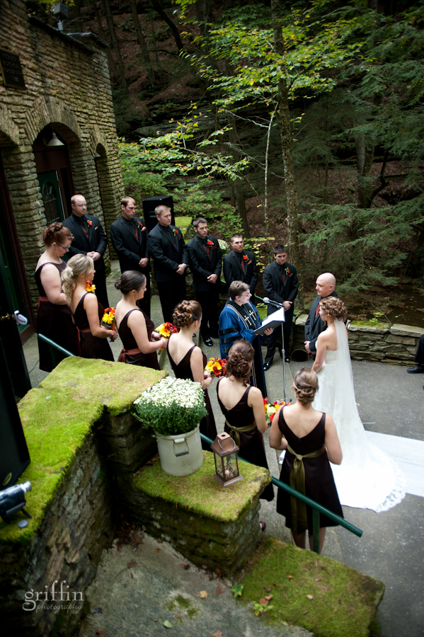 the bridal party laid out on the steps of the front of the brick building for the ceremony.