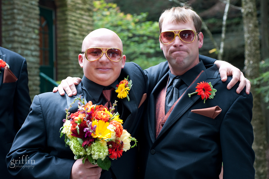The groom holding the bouquet with another goofy usher sporting their amazing sunglasses.