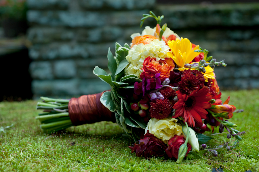 Ribbon wrapped autumn bridal bouquet set on a bed of green moss.