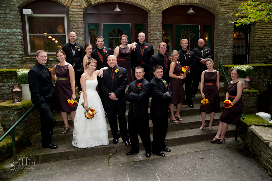 the entire bridal party on the steps in their mafia poses.