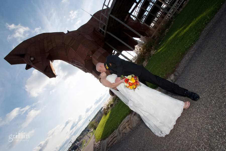 Jenelle and Casey kissing in front of Mt. Olympus' Trojan horse along the strip in the Dells.