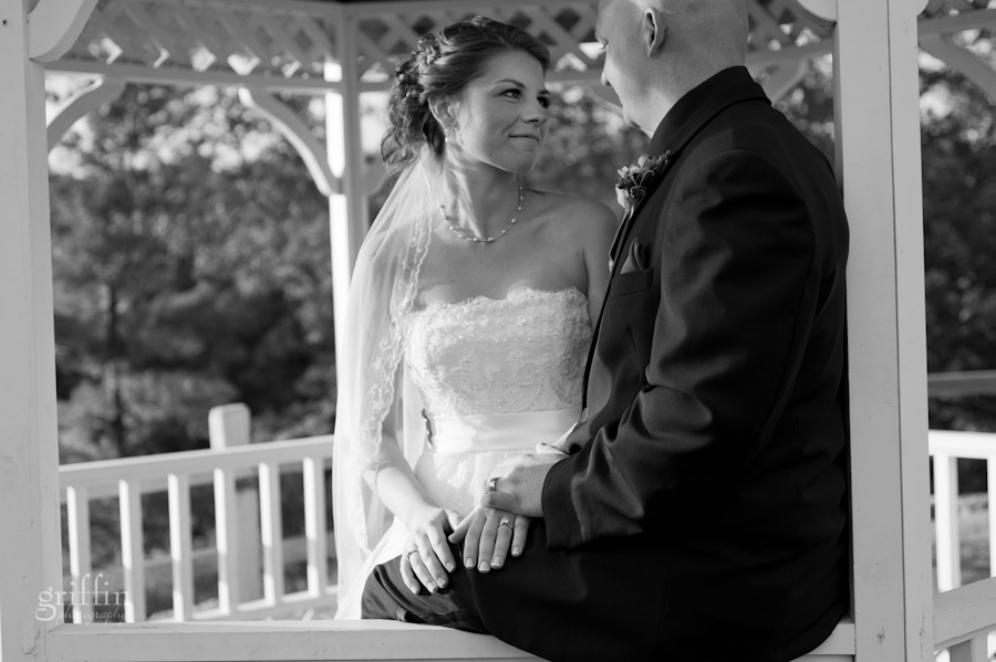 black and white of the wedding couple in the gazebo at Riverwalk along the Wisconsin River.