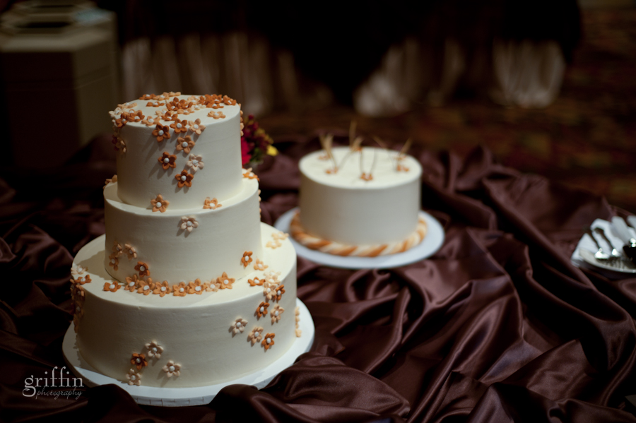 the Super delicious wedding cake on chocolate satin with tiny fondant flowers.