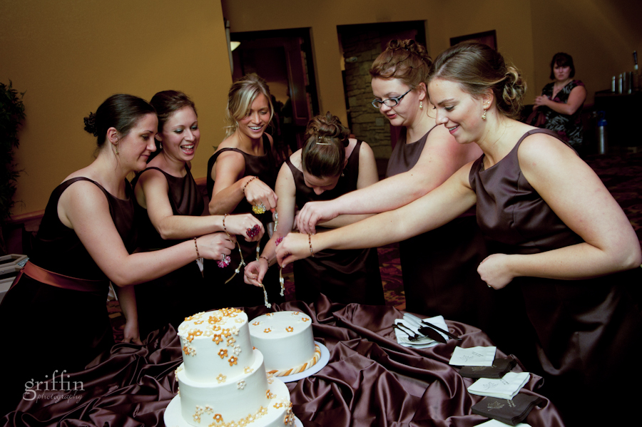 the bridesmaids pulling the charms out of the bridesmaid cake.