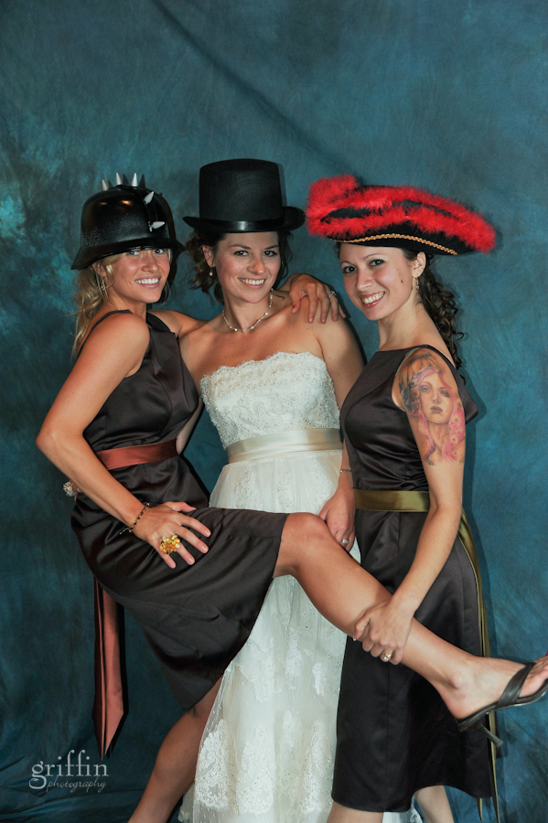a shot of the bride and two bridesmaids in our photo booth with their crazy hats.