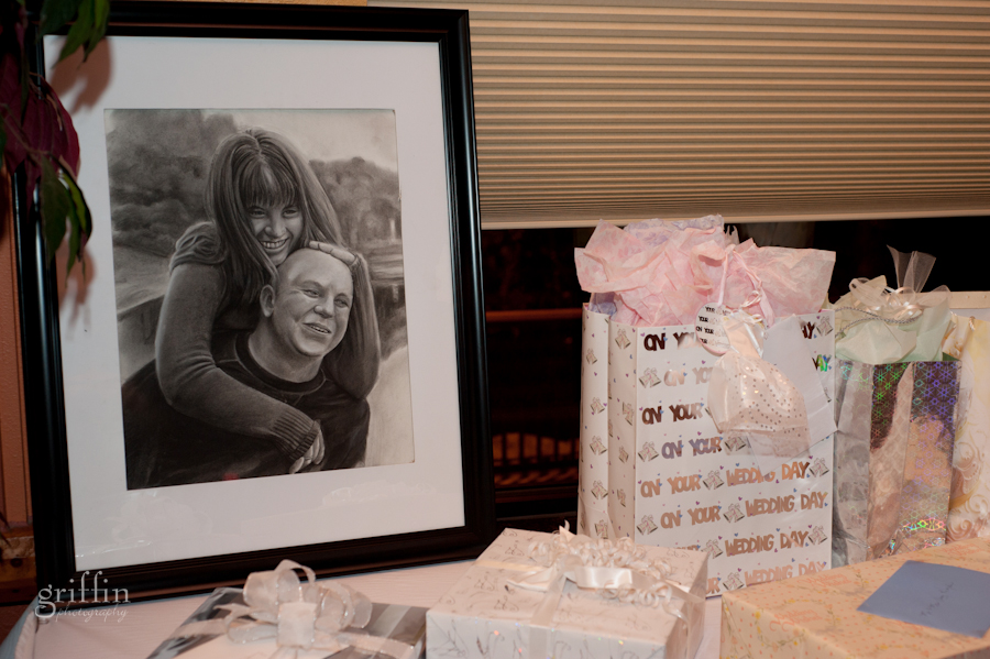 the gift table featuring a hand drawn portrait from one of our engagement shots drawn by the bride's brother.