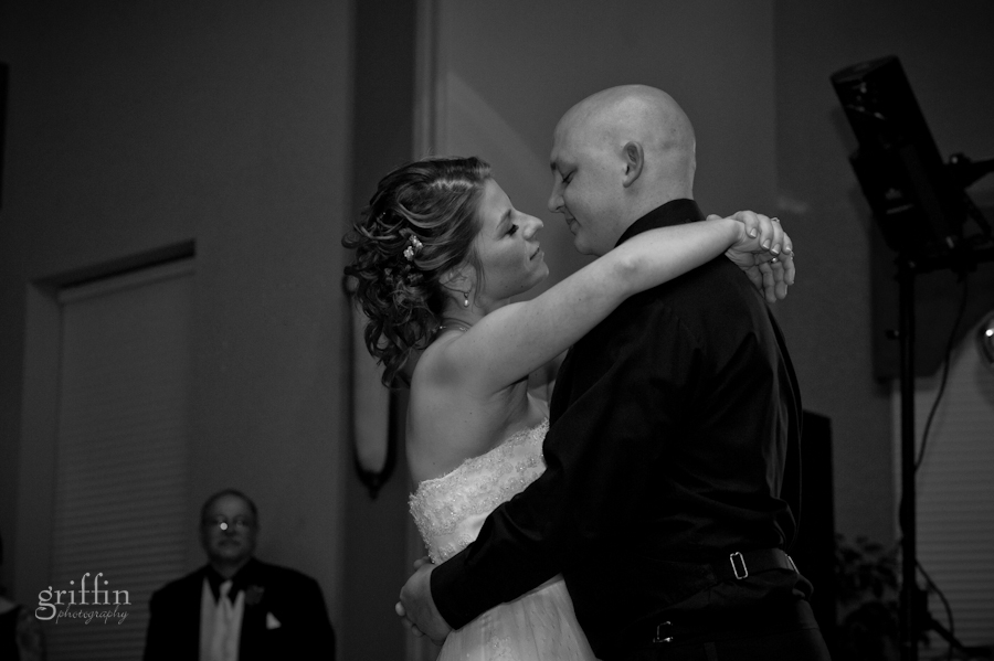 bride and groom about to kiss during their first glance in the Chula Vista grand ballroom.