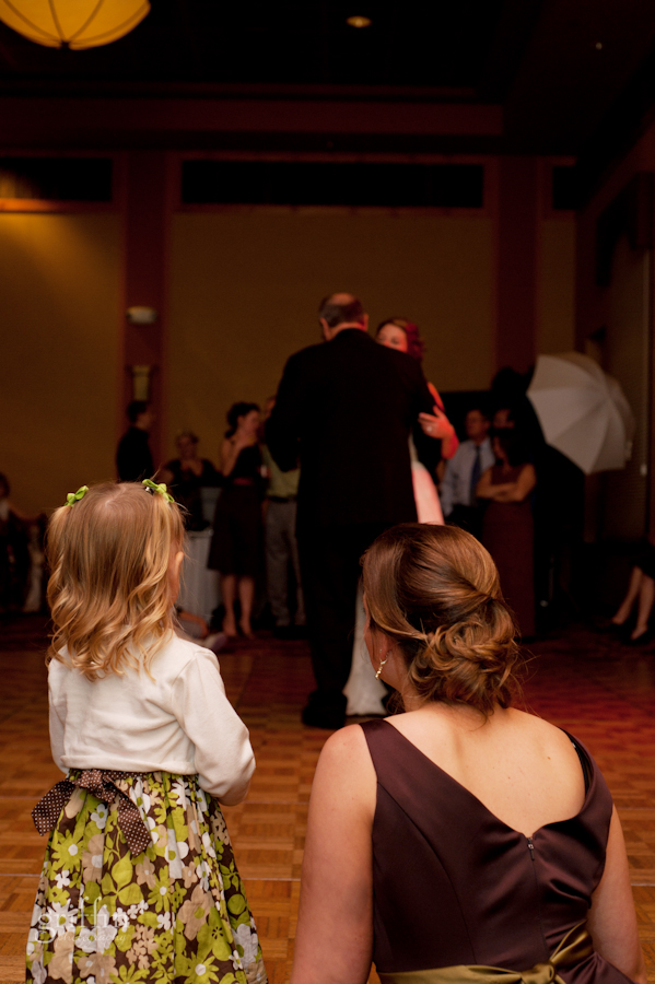 A couple of cute spectators watching the father daughter dance.