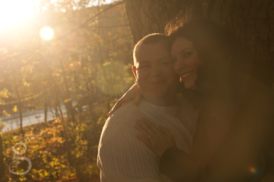 Gorgeous sun flares light up the couple as they hold each other at Devil's Lake State Park.
