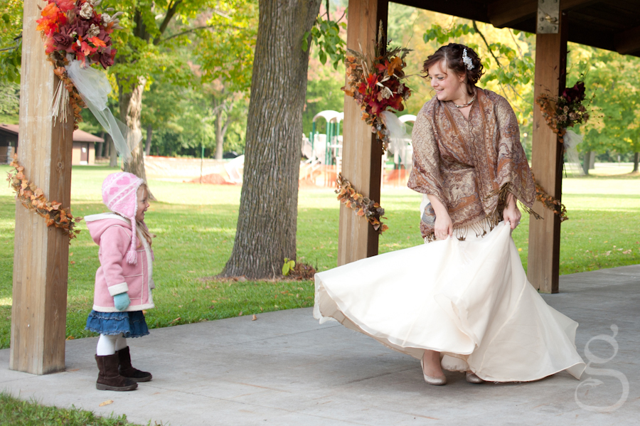 Harmony swinging her dress around while her niece laughs at her.