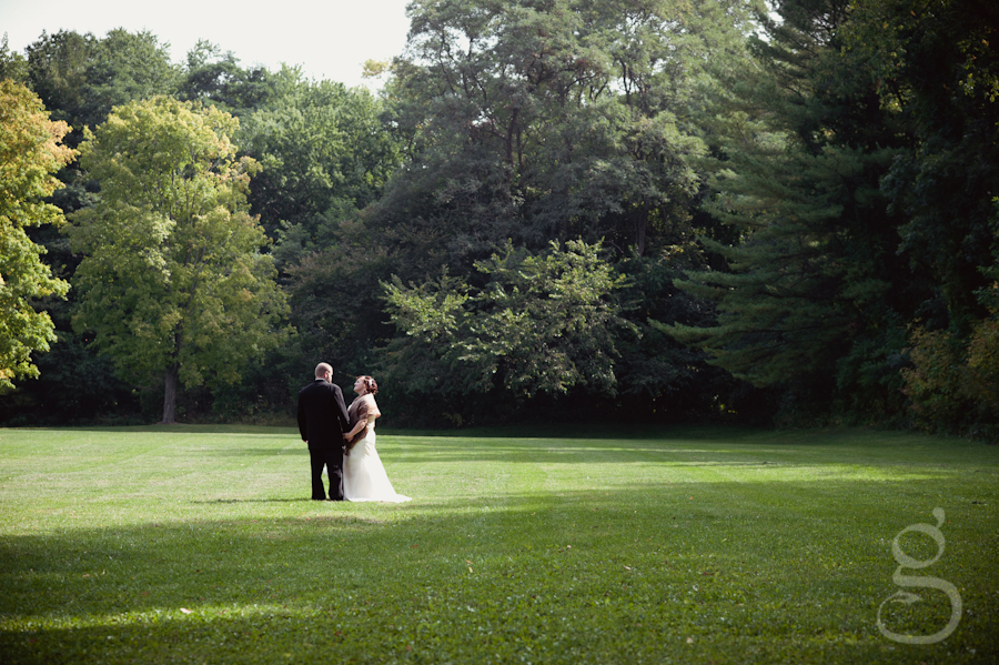 bride and groom on the grass covered lawn at the South Shore, Devil's Lake.