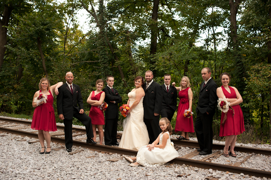Photograph of the entire wedding party on the railroad tracks.