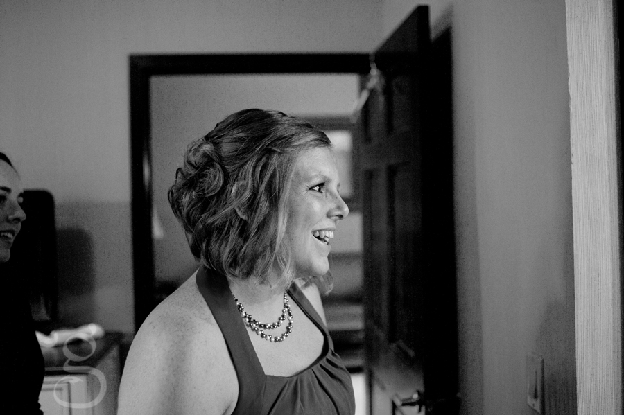 maid of honor looking at the bride as she gets ready.
