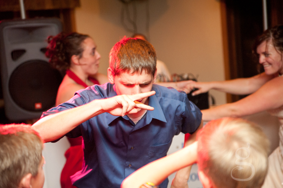 wedding guest dancing with red light on him.