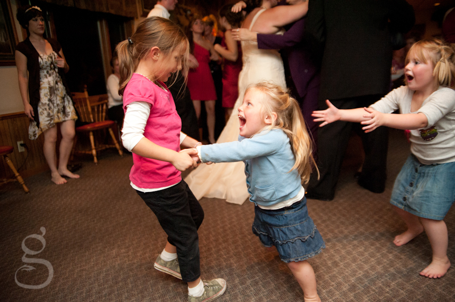 little girls dancing and laughing at the wedding reception in Merrimac.
