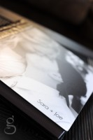 Light shinging on the metal cover of the wedding album.
