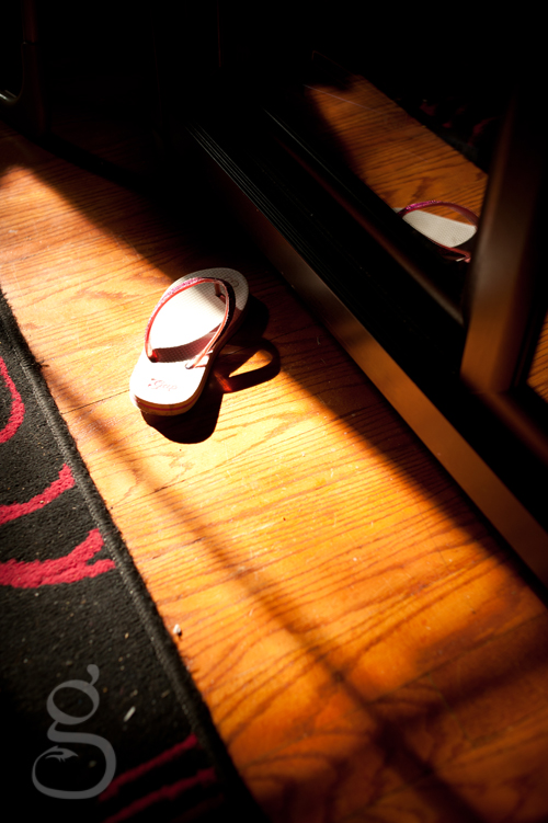 pink glitter sandal forgotten on the floor and captured in the late afternoon sunlight.