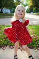 Jamie showing off her red polka dot dress with the sun flare behind her blonde head.