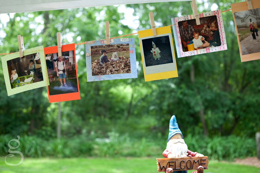 happy little gnome welcoming guests to Corwin and Stephanie's wedding, pictures of them as children hanging from the tent.