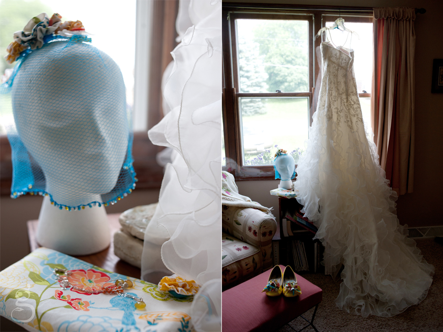 blue veil handmade from a loofah with the wedding dress hanging in front of the bedroom window.
