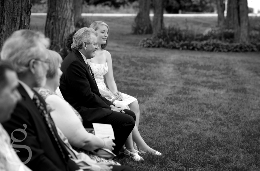 the groom's family watching the ceremony.