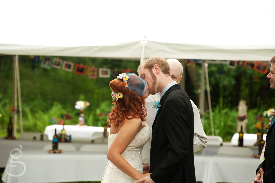 the bride and groom's first kiss as mr. and mrs.