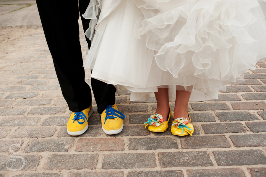 colorful yellow and blue wedding shoes with handmade flowers.