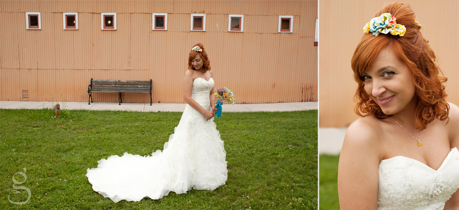 Stephanie, the beautiful bride, in front of the orange and red circus building.