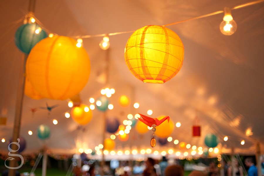 origami cranes, japanese paper lanterns, fairy lights and little metal cans hanging from the ceiling of the reception tent.