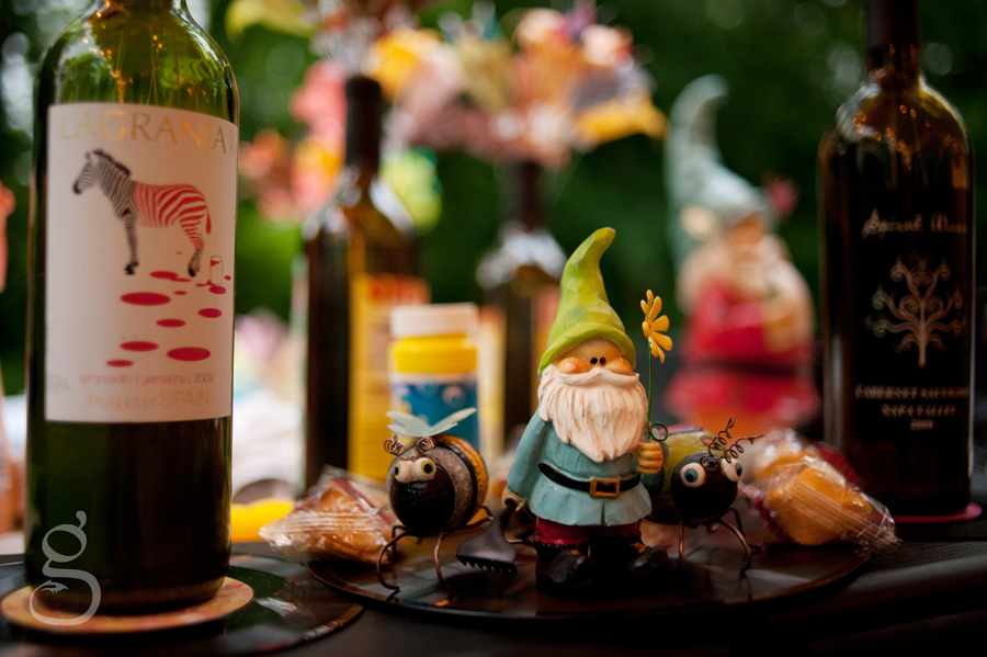 Bottles of wine sporting origami flowers on top of old records, wooden gnomes, bubbles and fortune cookies as the centerpieces.