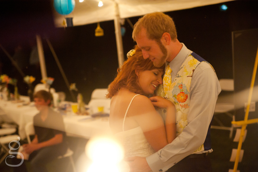 the bride and groom smiling and slowdancing at the end of the reception.