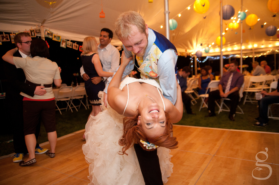 the bride being dipped by her groom on the dance floor.