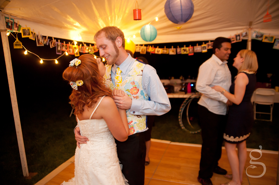 the bride and grom dancing close to one another.